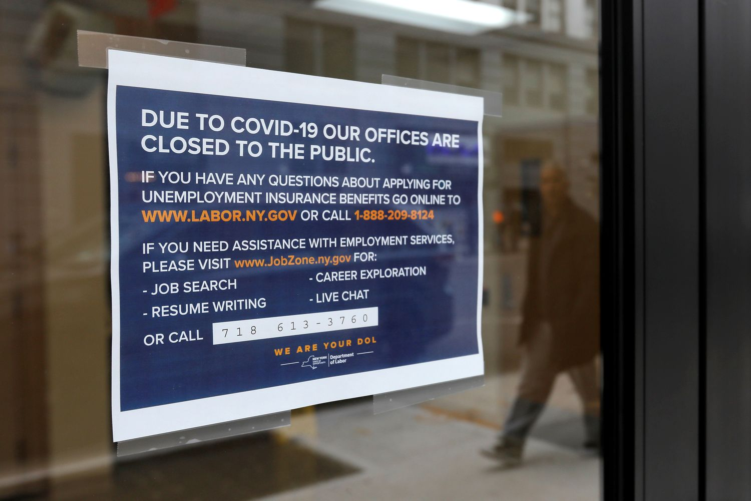 Signage is seen posted on the entrance of the New York State Department of Labor offices, which closed to the public due to the coronavirus disease outbreak in the Brooklyn borough of New York City on March 20. (Reuters photo)