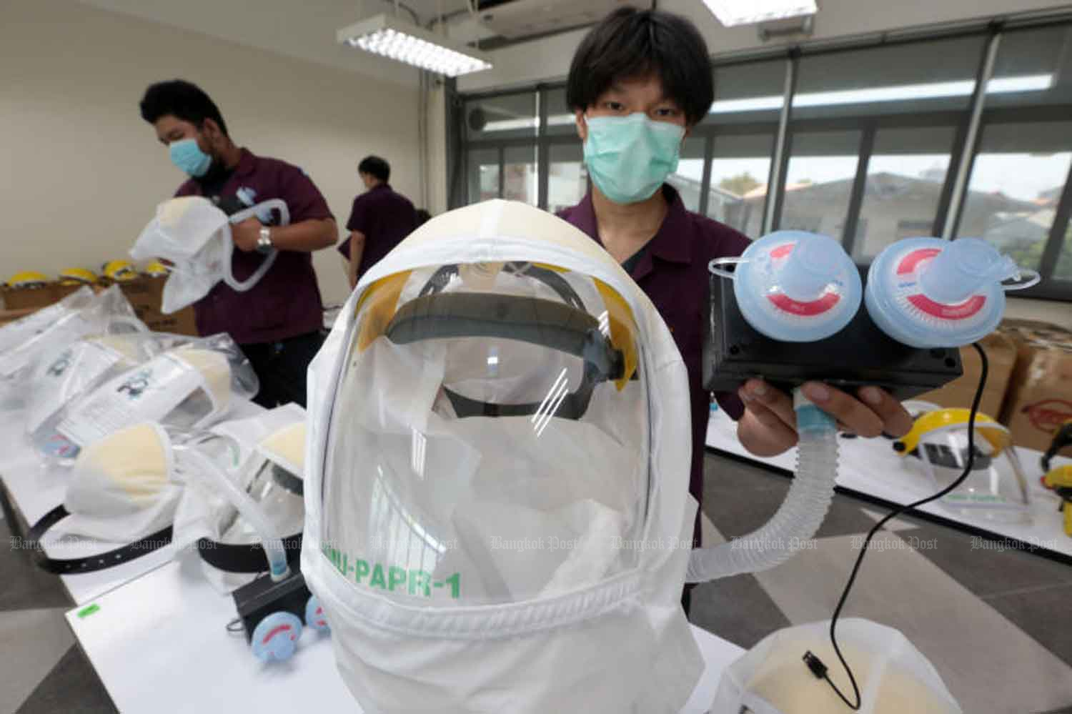 Powered air-purify respirator (PAPR) helmets are being developed by Vajira Hospital's Faculty of Medicine for use among hospitals treating Covid-19 patients with critical conditions to better protect medical personnel against the virus. (Photo by Chanat Katanyu)