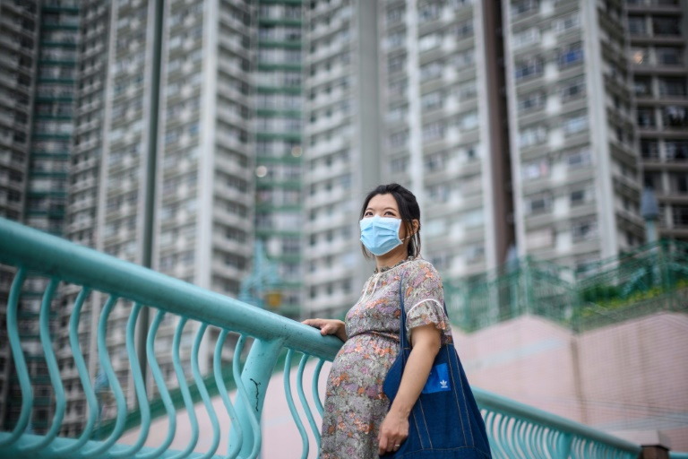 Jamie Chui has been a virtual prisoner in her Hong Kong home for most of her pregnancy, trapped intially by violent pro-democracy protests and tear gas, and then by the coronavirus -- she now faces giving birth alone.
