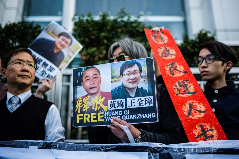 Hong Kong pro-democracy activists attend a protest in support of jailed Chinese human rights lawyer Wang Quanzhang (right on placard) and China's first