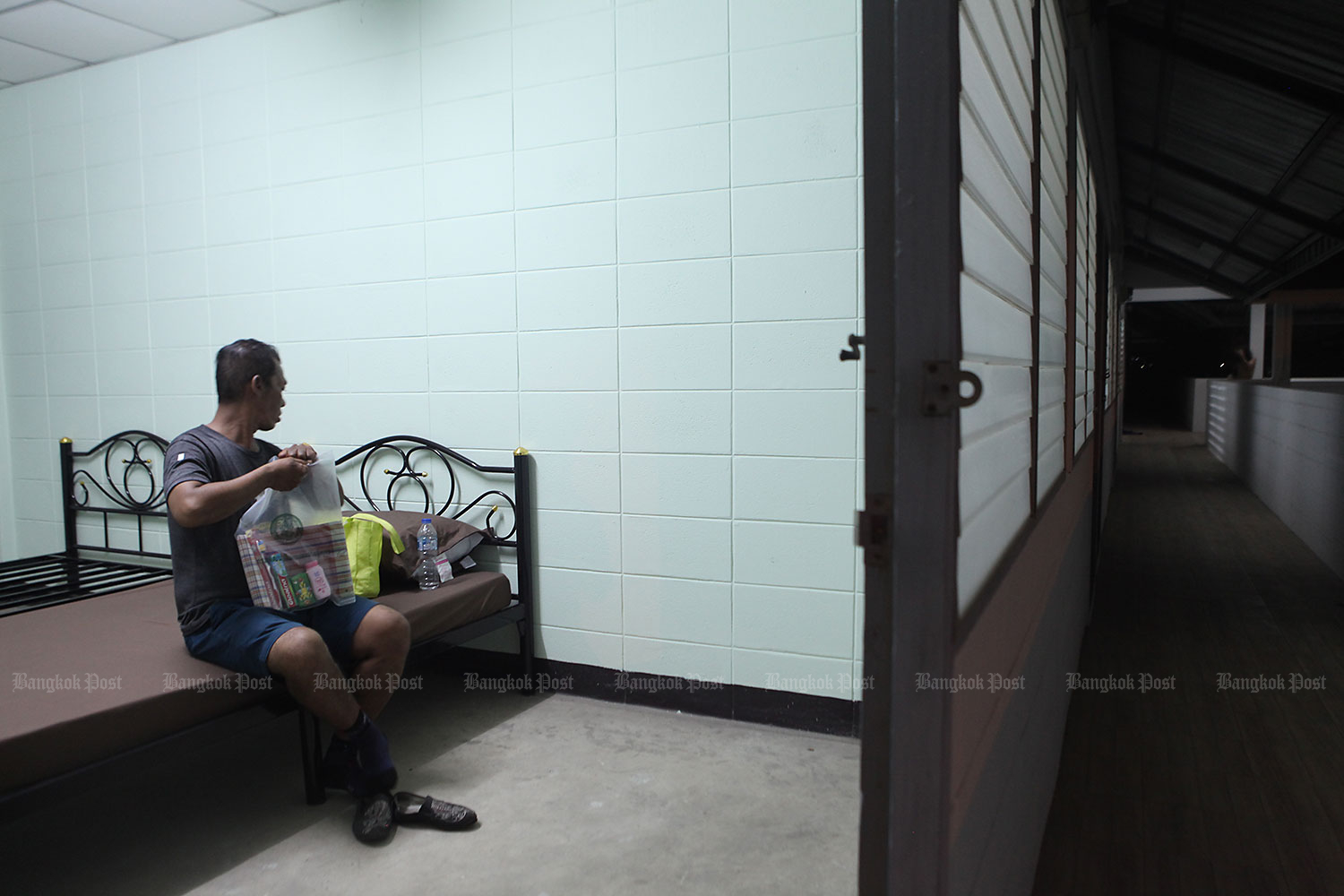 Safe, for now: A man settles in at a homeless shelter in On Nut Soi 40 in Bangkok's Prawet district. A number of homeless people from the Hua Lamphong and Lumpini areas are being temporarily housed at the shelter to reduce their risk of contracting Covid-19. (Photo by Arnun Chonmahatrakool)
