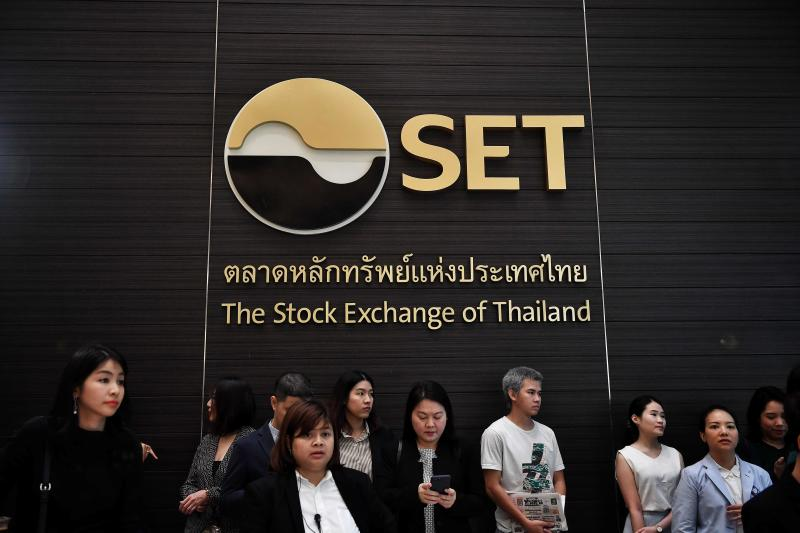 Attendees wait for Central Retail Corporation to open trading as Thailand's largest IPO at the Stock Exchange of Thailand in Bangkok on Feb 20, 2020. (AFP file photo)