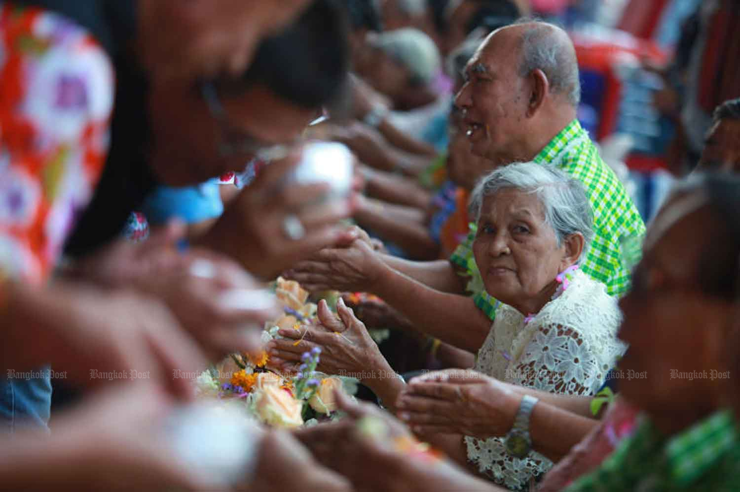 Thai people traditionally extend their best wishes to elderly people during the Songkran festival. (Bangkok Post file photo)
