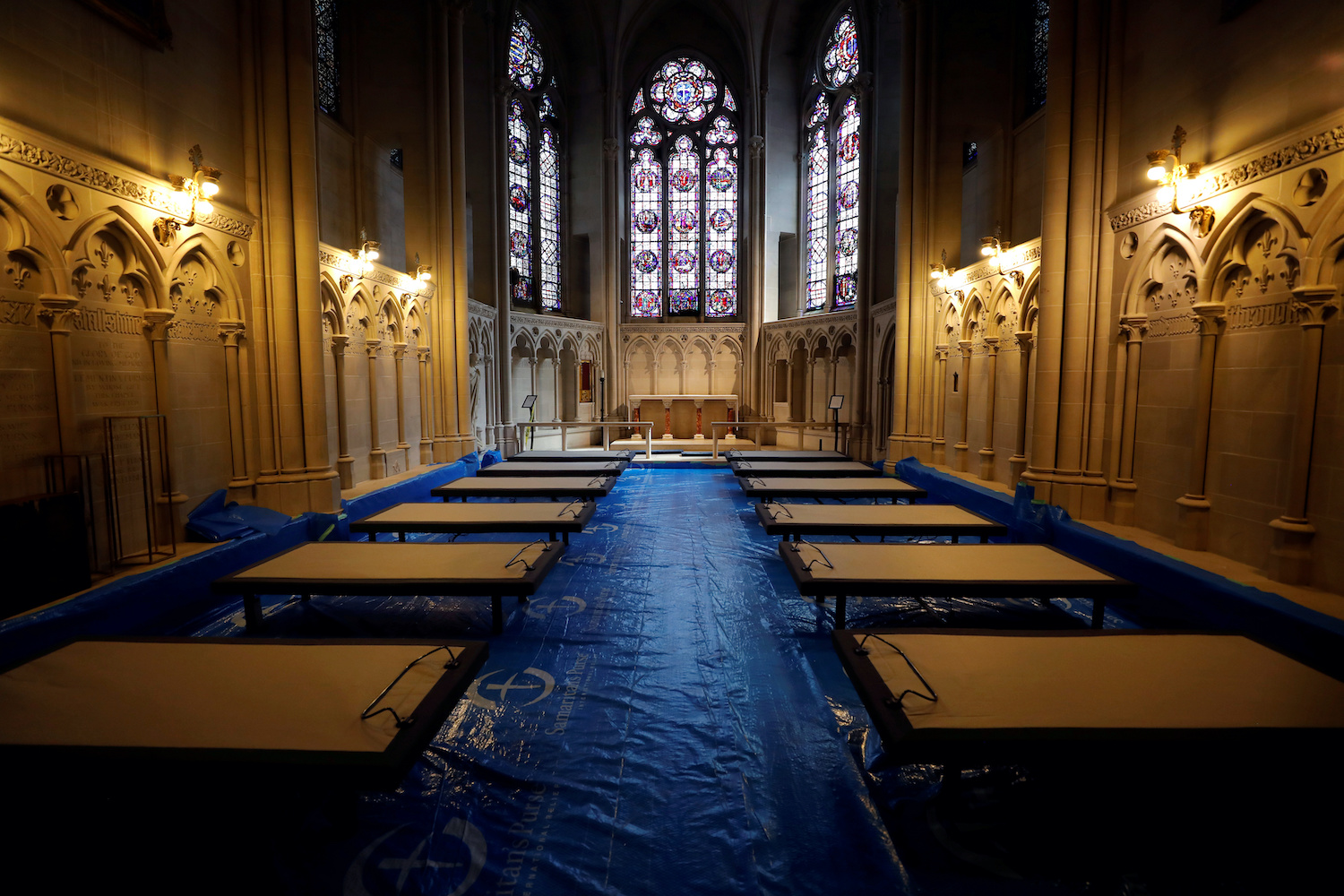 Hospital beds are laid out in a chapel inside the Cathedral Church of St John the Divine for a temporary field hospital to deal with coronavirus patients in New York City. (Reuters Photo)