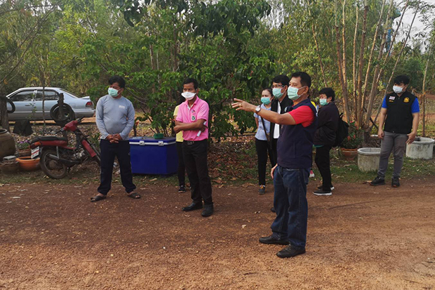Public health officials inspect Ban Don Thong in Si Songkhram district of Nakhon Phanom on Sunday after a Covid-19 patient was reported in the village. (Photo by Pattanapong Sripiachai).