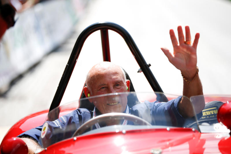 Stirling Moss waves to spectators as he sits in his 1955 Ferrari 750 Monza during the Ennstal Classic rally near the Austrian village of Groebming July 20, 2013. (Reuters photo)