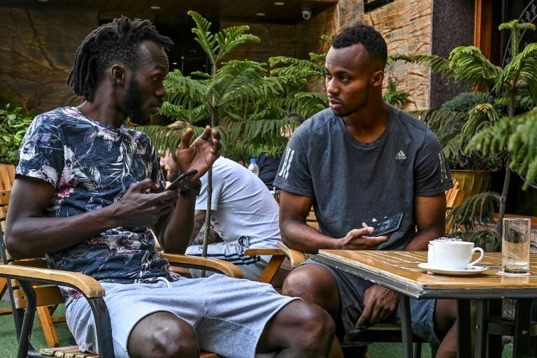 Real Kashmir players Armand Bazie (left) and Gnohere Krizo of Ivory Coast talk in their Srinagar hotel restaurant during the coronavirus lockdown