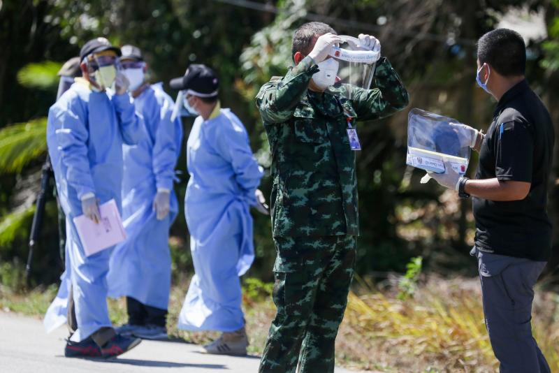 FILE PHOTO: Health officials wearing protective clothing as preventive measure against Covid-19 coronavirus guard a checkpoint for returning Thai residents from Malaysia in Nong Chik district in Thailand's southern province of Pattani on April 2, 2020. (AFP)