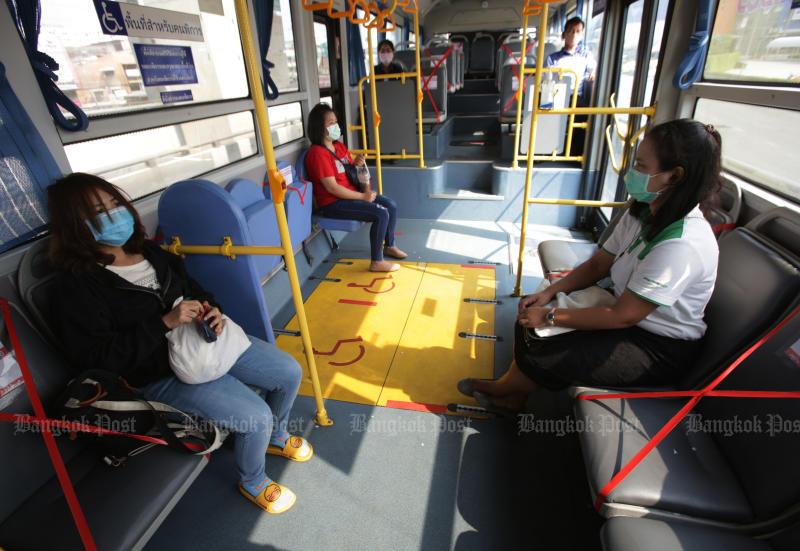 Passengers maintain social distance on board a Bangkok bus. (Photo by Apichit Jinakul)