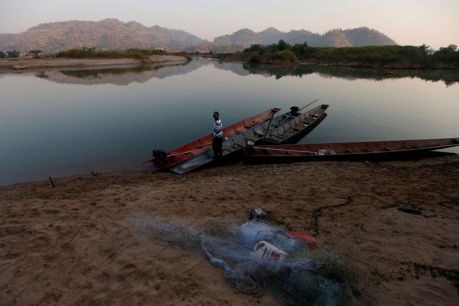 A fisherman is seen on the Mekong river bank outside Nong Khai province on Jan 10 this year. (Reuters photo)