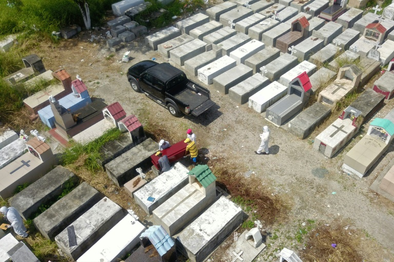 Mortuary workers in the Pacific port city of Guayaquil have been unable to cope with a backlog.