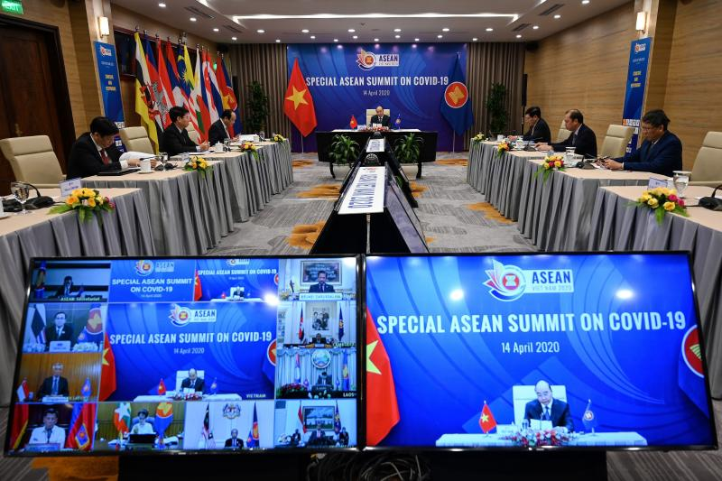 Vietnam's Prime Minister Nguyen Xuan Phuc (centre) addresses a live video conference on the special Association of Southeast Asian Nations (Asean) Summit on the Covid-19 coronavirus pandemic in Hanoi on Tuesday. (AFP photo)