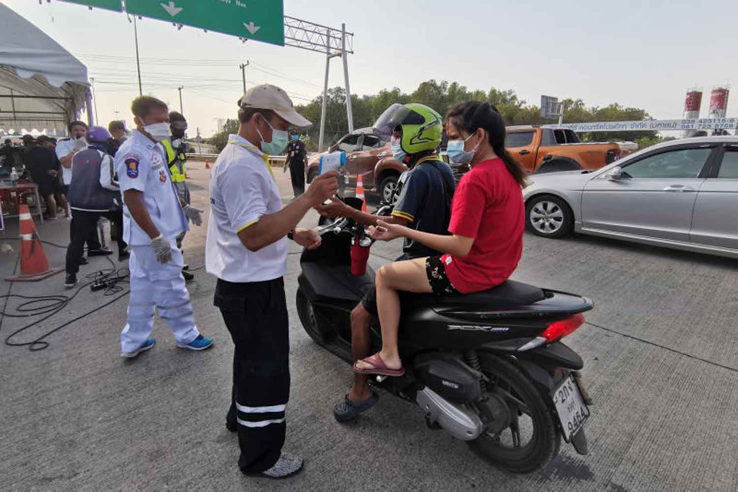 Officials perform health screenings in Pattaya City early this month. (Photo from Pattaya City)
