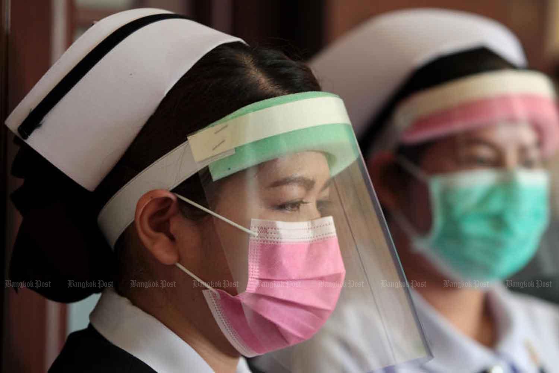 Medical staff with makeshift face shields at Siriraj Hospital in Bangkok. (Photo by Chanat Katanyu)