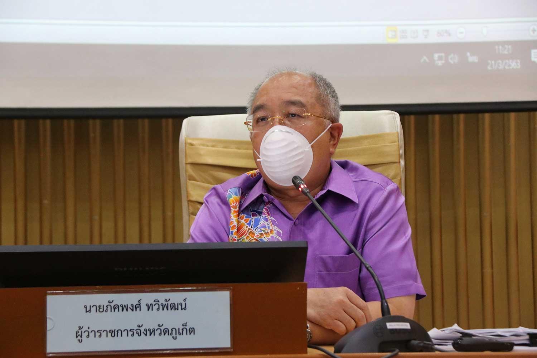 Phuket governor Phakaphong Tavipatana briefs the media on the spread of Covid-19 in the tourist province. (Photo: Achadtaya Chuenniran)