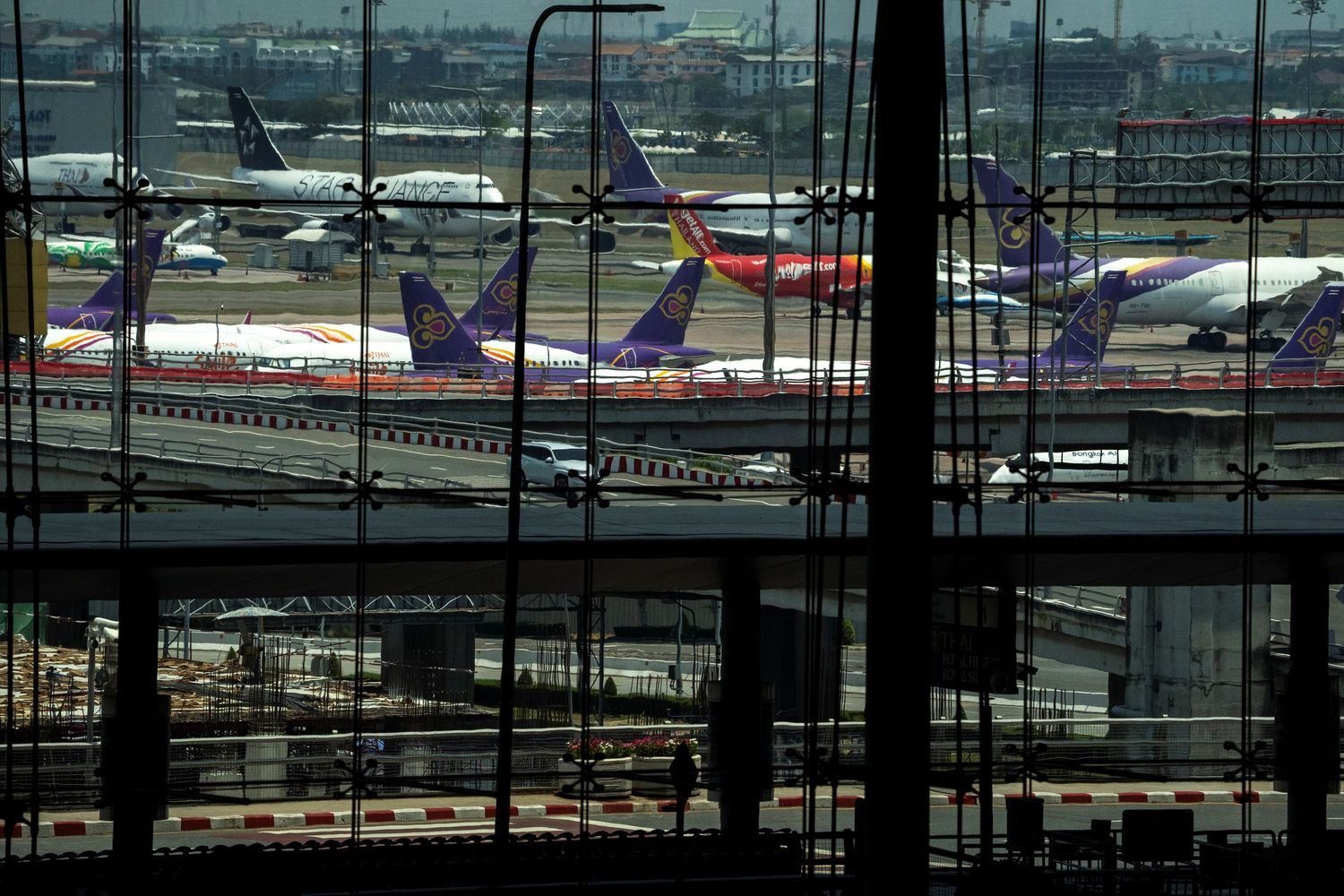 THAI planes park at the tarmac of the Suvarnabhumi airport in Bangkok on April 4. (Reuters photo)