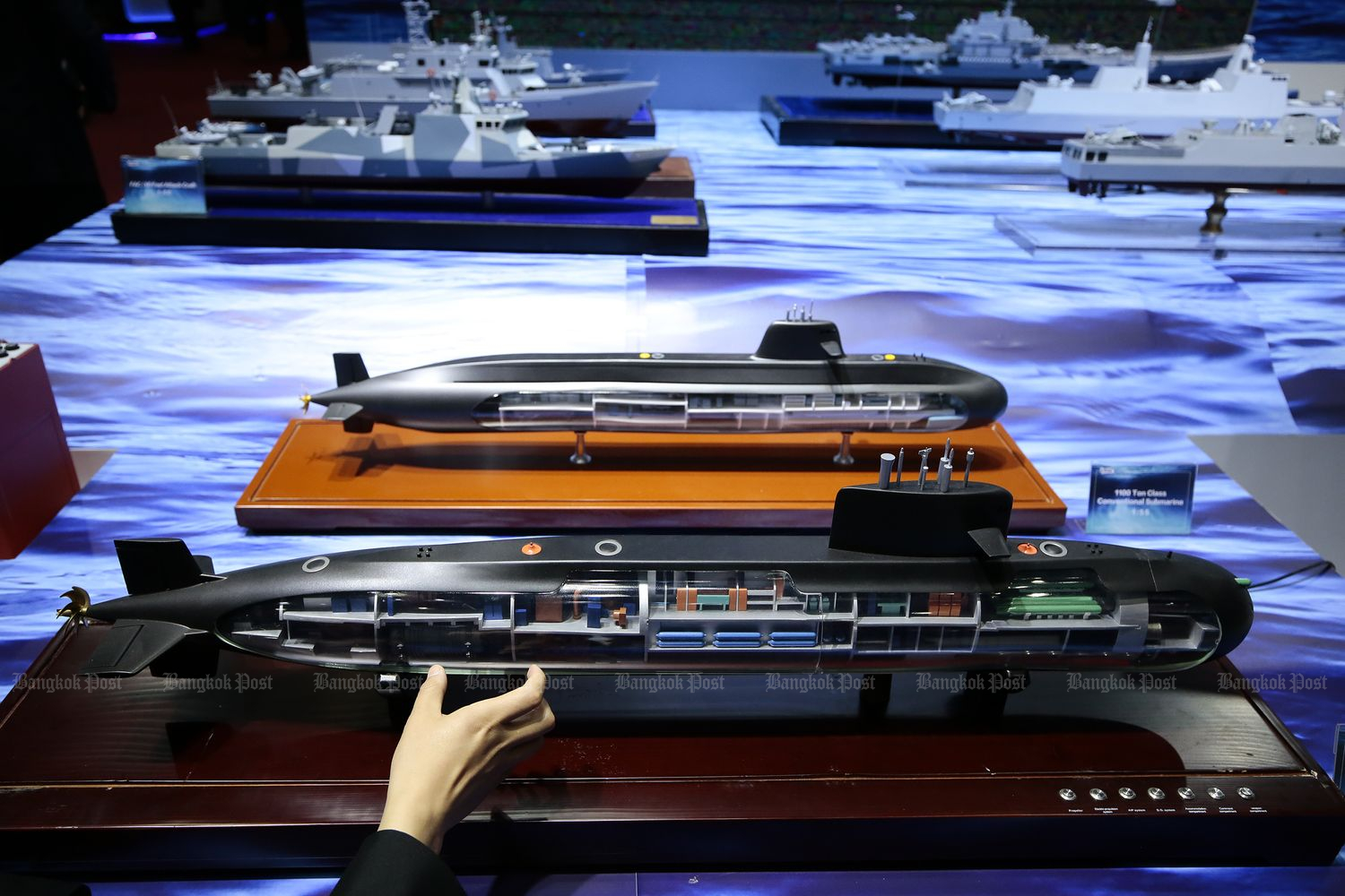 Models of Chinese submarines are displayed at a defence exhibition held in Nonthaburi in November last year. (Photo by Patipat Janthong)