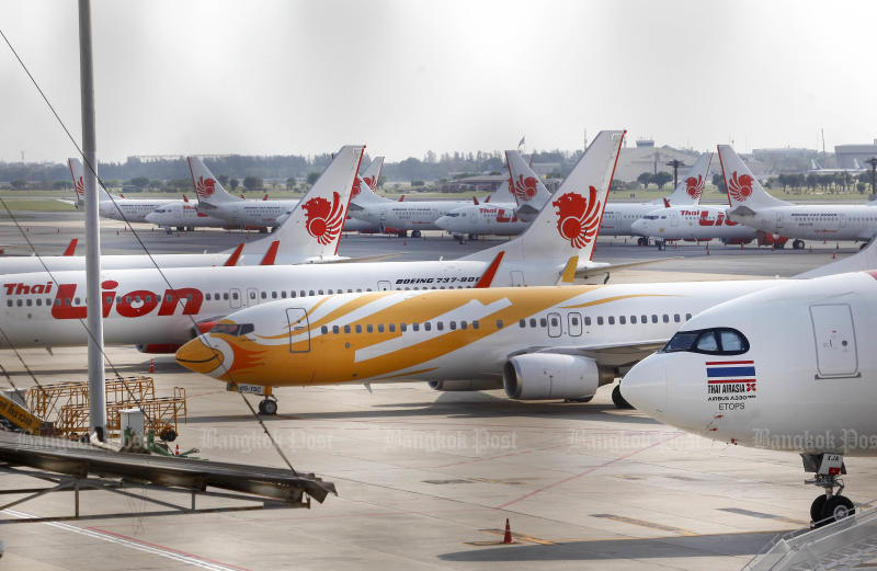 Thai Lion Air planes are among aircraft seen parked on the tarmac of Don Mueang airport after the airline suspended flights. (Photo by Pattarapong Chatpattarasill)
