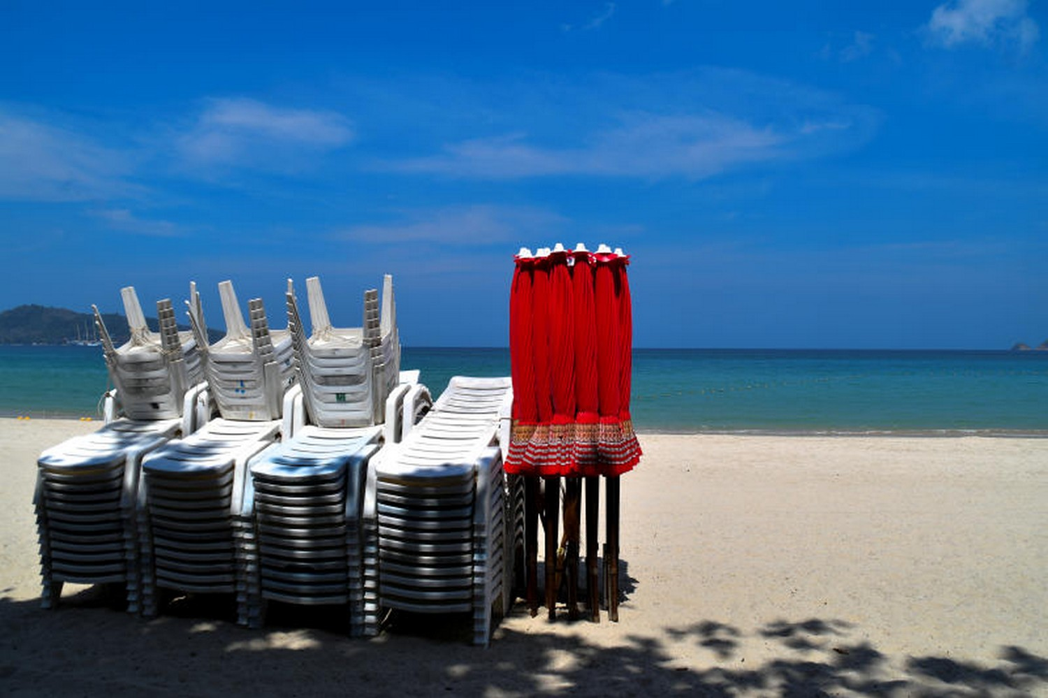Folded chairs and umbrellas at deserted Patong beach, Phuket. (Photo: Reuters)