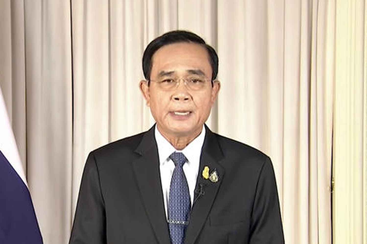 Prime Minsiter Prayut Chan-o-cha announces a state of emergency to deal with the coronavirus pandemic in a nationwide television broadcast last month. He has now asked the country's richest people to implement projects to help affected people. (Photo:  Television Pool)