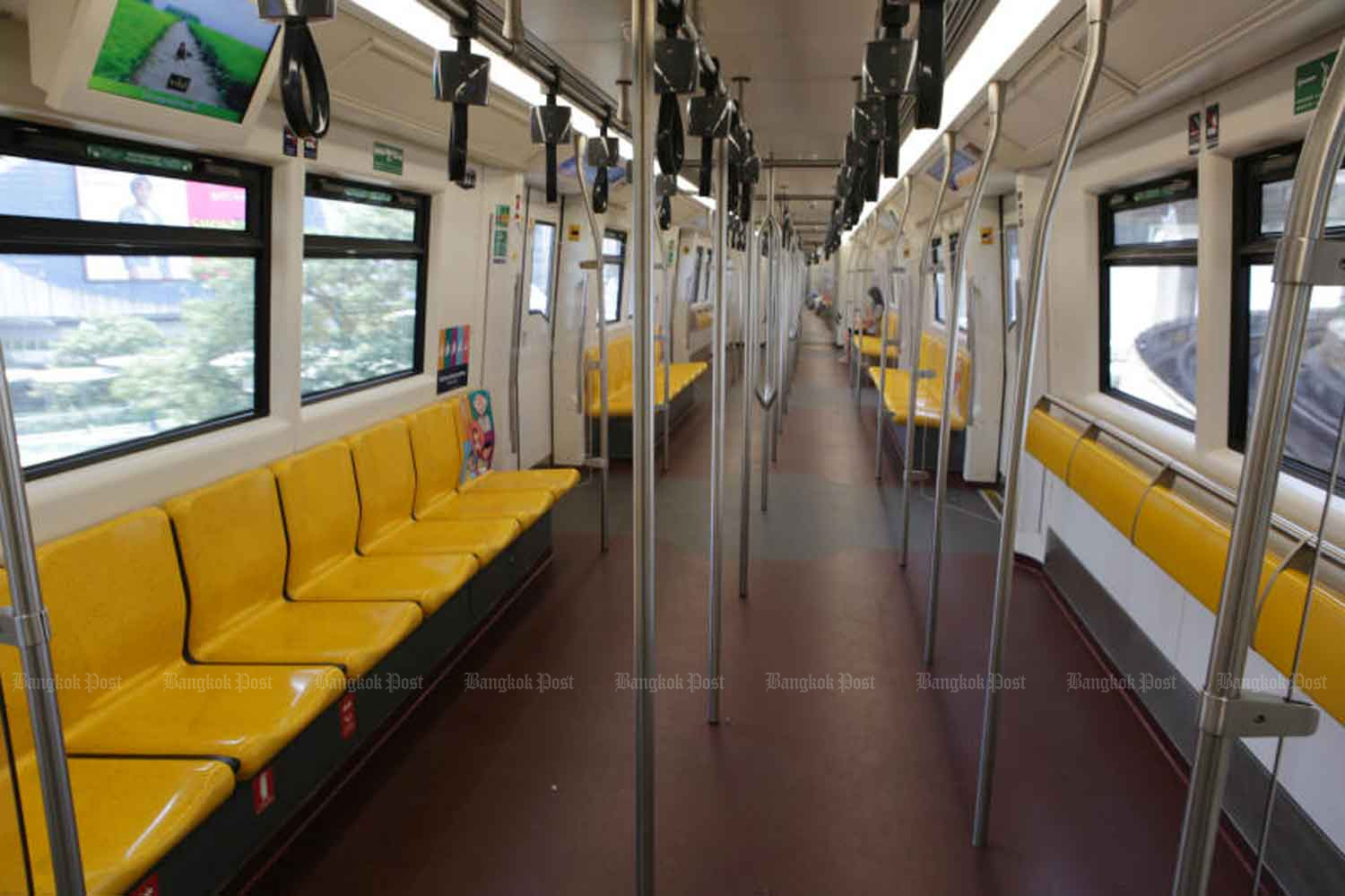 A Bangkok electric train is almost empty as many people switch to working from home because of Covid-19. The government has agreed to either waive or cut electricity charges for 22 million households whose power consumption has gone up as a result. (Photo: Apichit Jinakul)