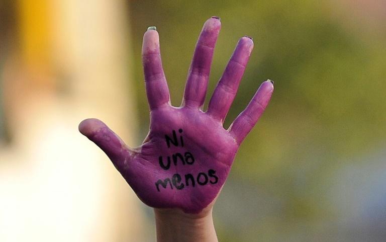 An activist displays her hand reading