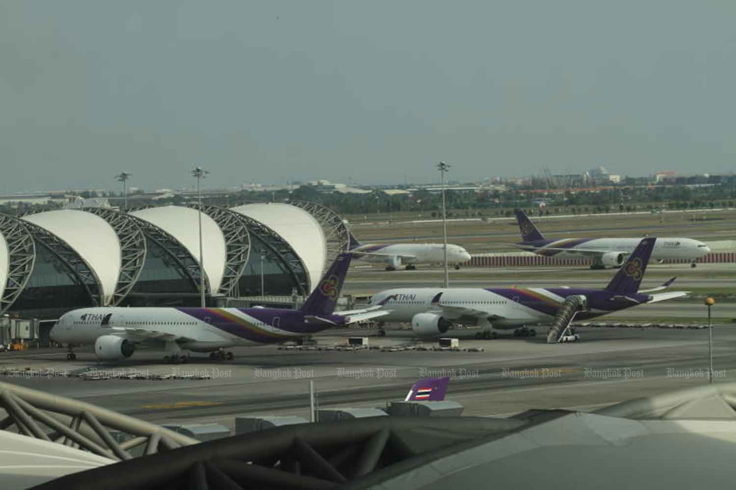 Aircraft are parked at Suvarnabhumi airport due to Covid-19. (Photo by Nutthawat Wicheanbut)