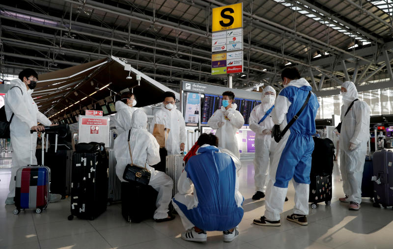 Chinese students living in Thailand wear protective suits as a measure of protection against the coronavirus disease at Suvarnabhumi Airport before boarding a repatriation flight on Tuesday. (Reuters photo)