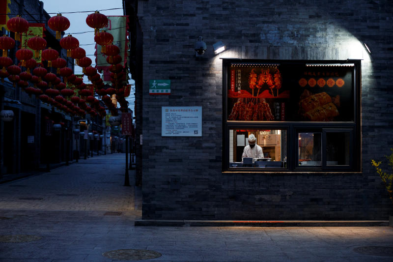 A chef prepares food in the Qianmen district, one of the top tourist destinations in Beijing, as the spread of the novel coronavirus disease continues in China on April 8, 2020. (Reuters photo)