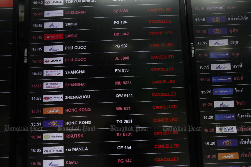 A flight information panel at Suvarnabhumi airport shows cancelled flights. (Photo: Nutthawat Wicheanbut)