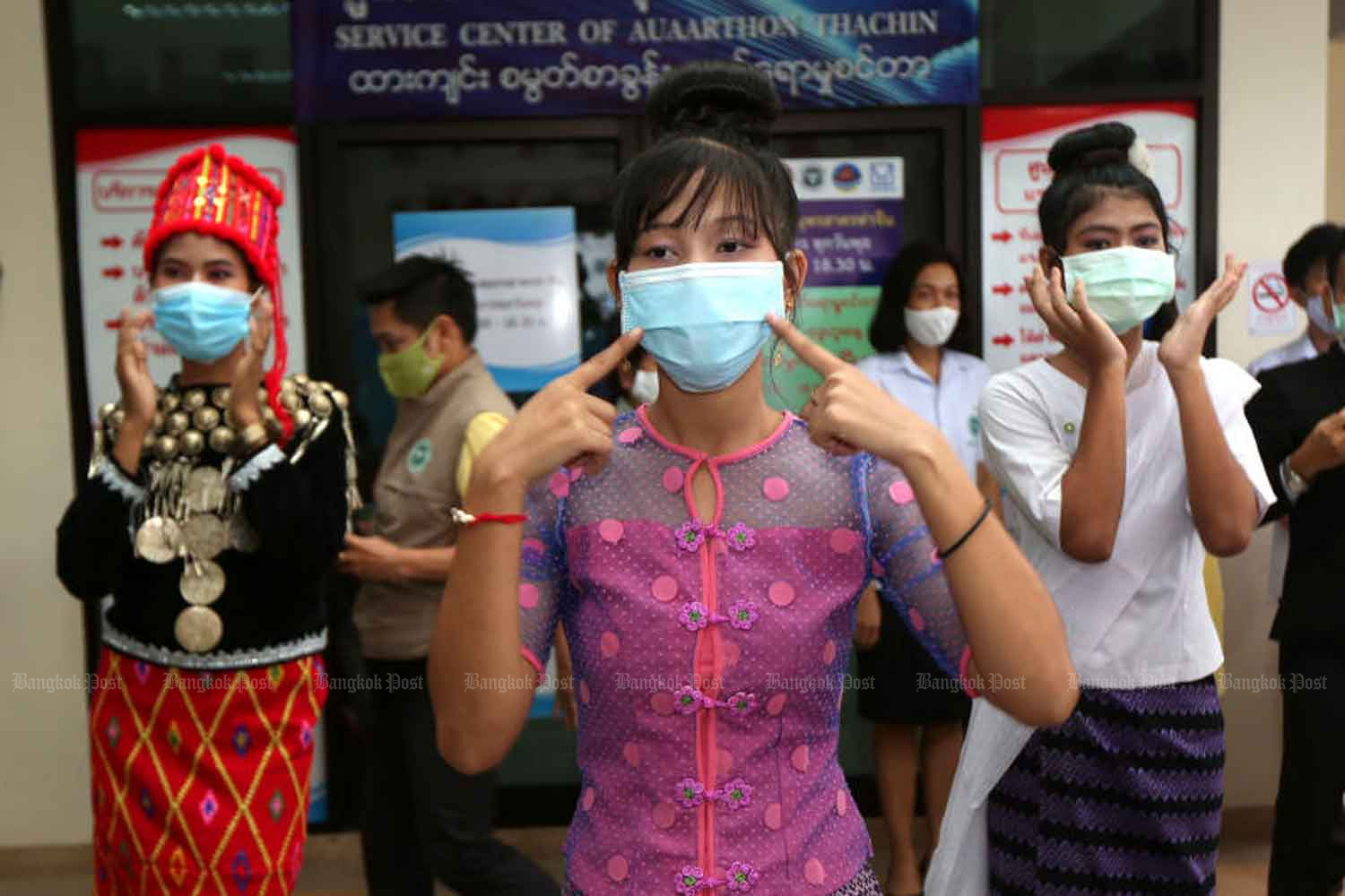 Health volunteers take part in an activity to raise awareness about Covid-19 among migrant labourers in Muang district of Samut Sakhon. The province has the largest migrant worker population in Thailand. Varuth Hirunyatheb