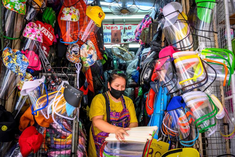A vendor sells plastic face shields as protection against Covid-19 coronavirus at a stall in Bangkok on Monday. (AFP photo)
