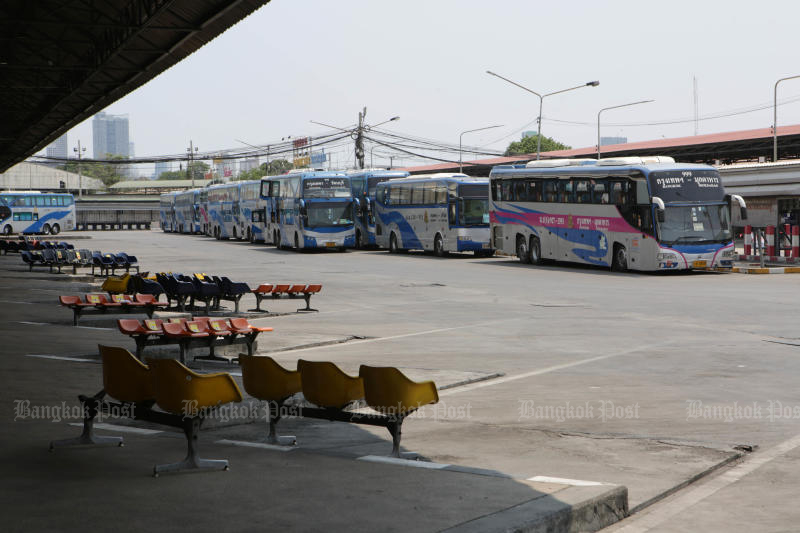 Long-haul buses operated by Transport Co remain parked at Mor Chit bus terminal, with   services on routes longer than 300 kilometres still suspended. (Photo: Apichit Jinakul)