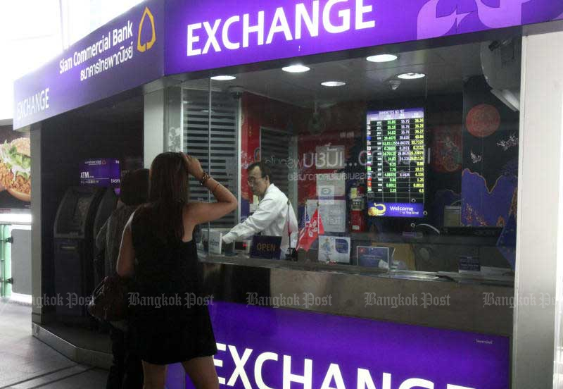 The coronavirus impact and inbound flight bans deal a severe blow to the money-changing business. (Bangkok Post file photo)