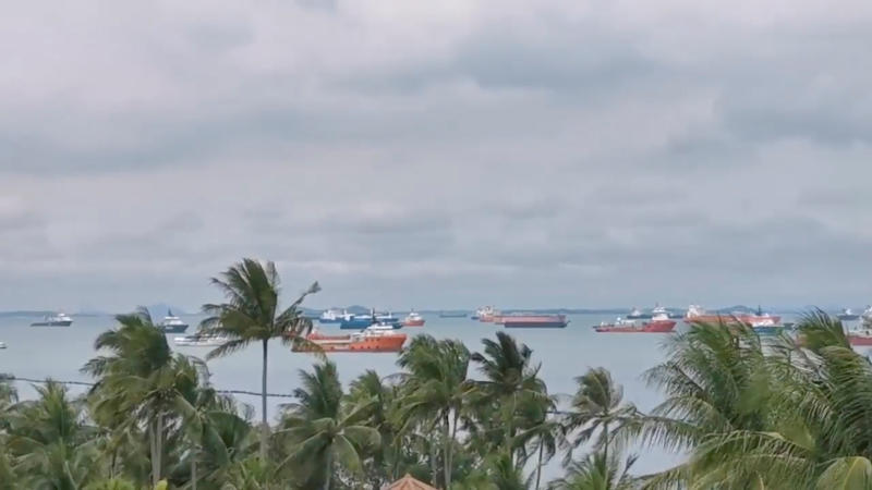 Working ships gather to sound their horns during the outbreak of the coronavirus disease, in Singapore, May 1, 2020 in this still image taken from a social media video. (Drilling Rig Surveyor Tan Sze Liang/via Reuters)