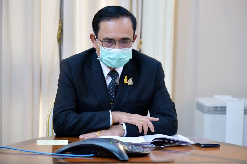 This handout from the Royal Thai Government taken on May 1, 2020 shows Prime Minister Prayut Chan-o-cha talking to his Indian counterpart Narendra Modi about the Covid-19 novel coronavirus situation during a phone call in Bangkok. (AFP PHOTO / ROYAL THAI GOVERNMENT)