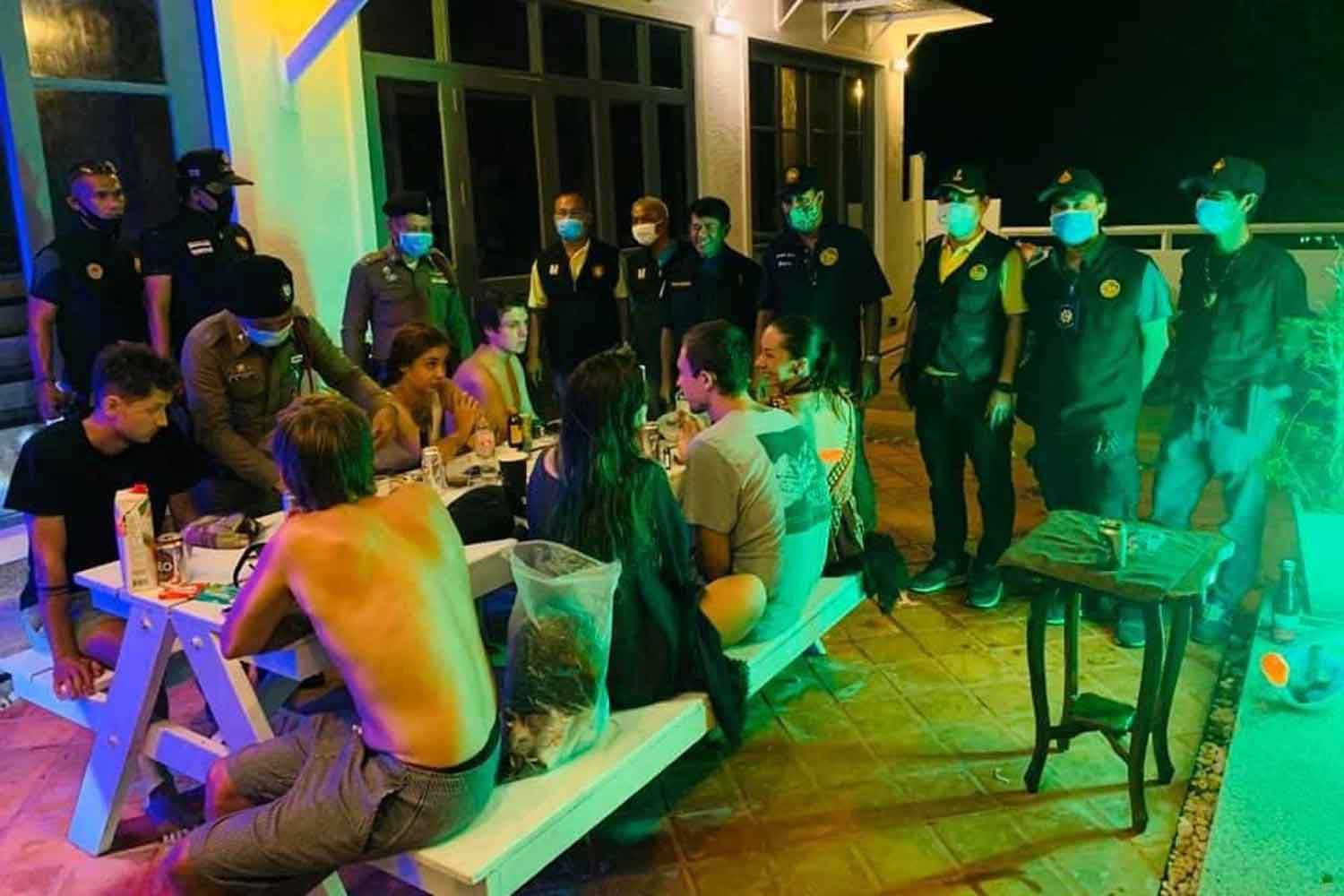 Seven Russian tourists are caught partying in a house on Koh Phangan island, Surat Thani, in violation of the emergency decree curfew. (Photo: Supapong Chaolan)