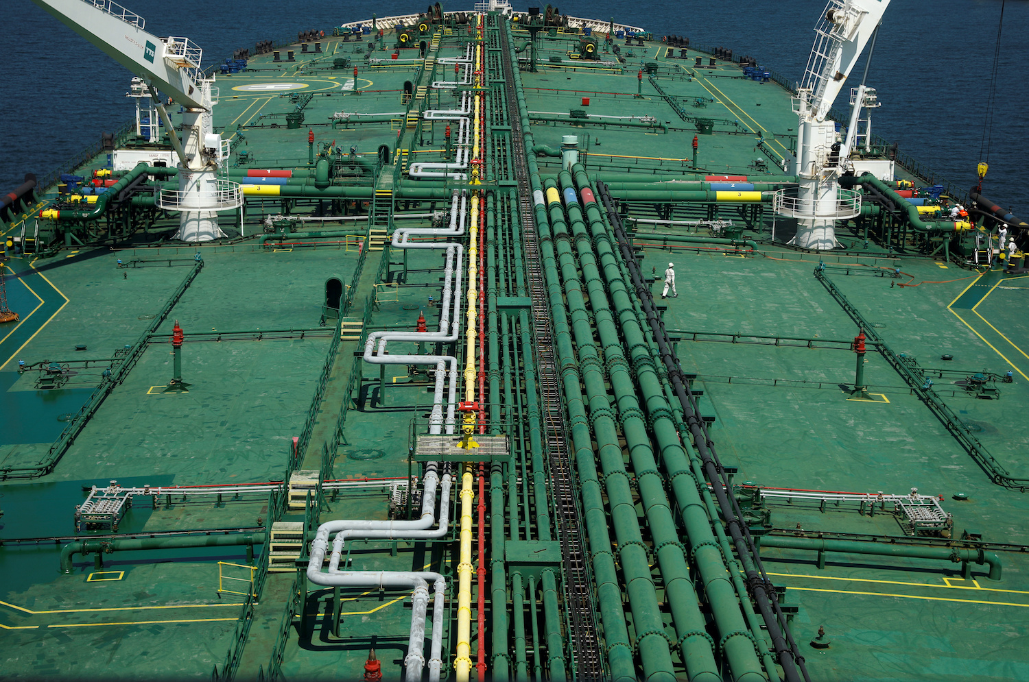 In an image from July last year, pipelines run along the deck of the supertanker Pu Tuo San, owned by the disgraced oil trading firm Hin Leong, in the waters off Jurong Island in Singapore. (Reuters Photo)
