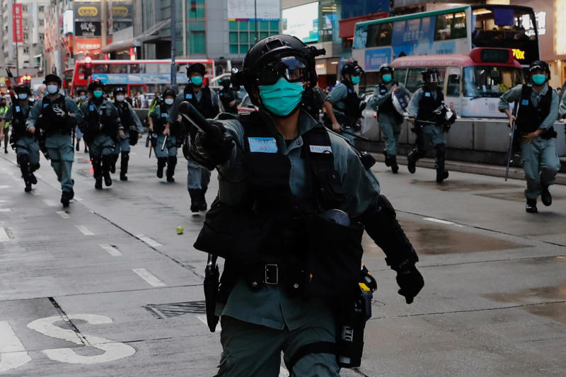 Riot police disperse anti-government protesters during a protest at Mong Kok in Hong Kong, China on Sunday. (Reuters photo)