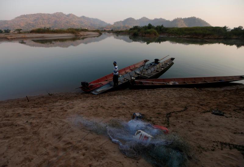 A fisherman is seen on the Mekong River bank outside Nong Khai on Jan 10, 2020. (Reuters photo)