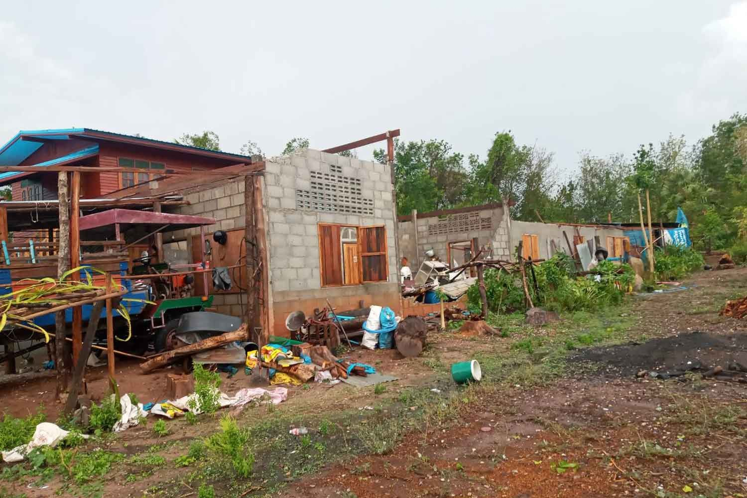 Houses in Thong Saen Khan district, Uttaradit province, damaged by a violent storm on Monday.