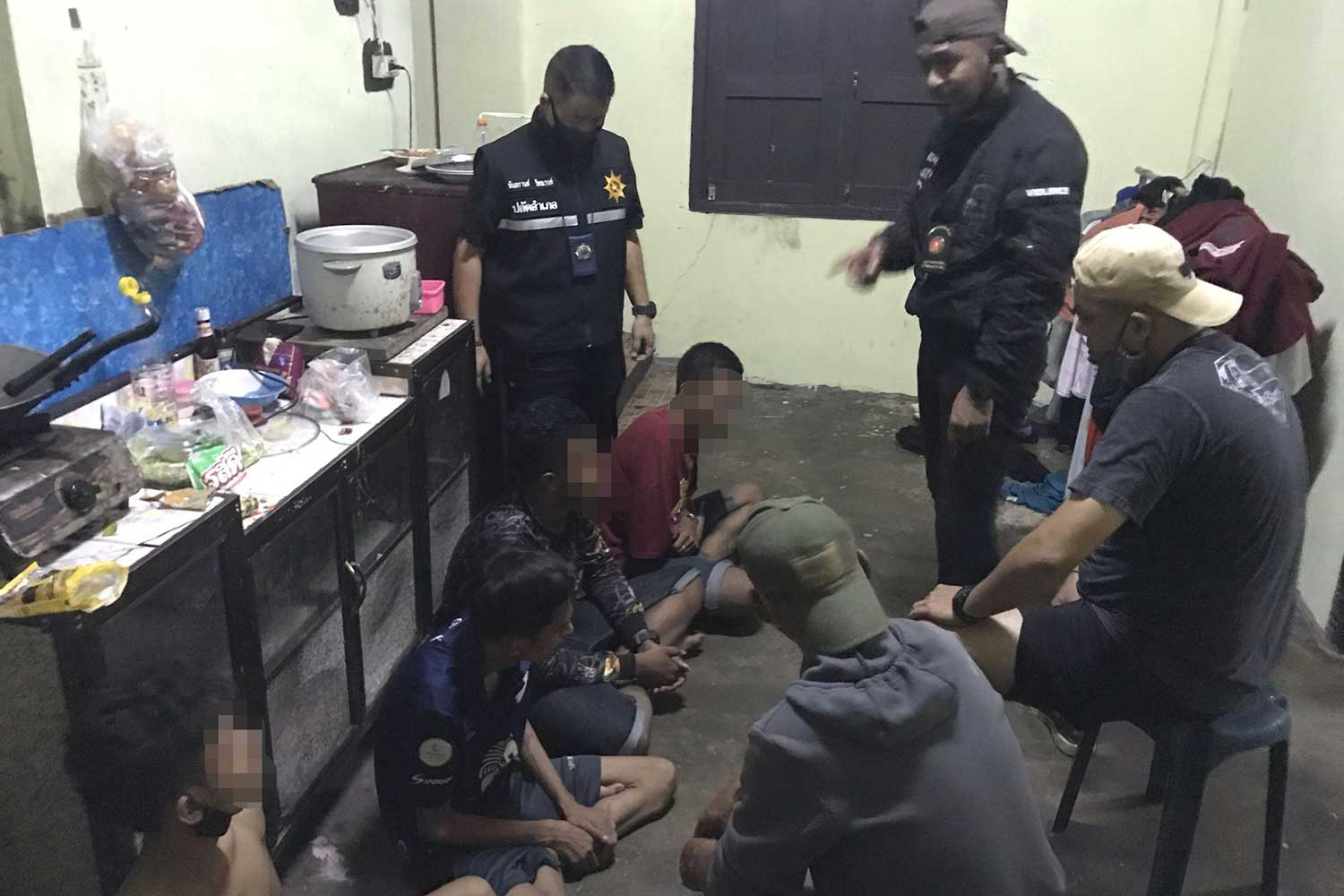 Local officials question some of the young people arrested during the raid on a house in Songkhla's Hat Yai district being used for taking drugs and partying on Monday night. (Photo: Assawin Pakkawan)
