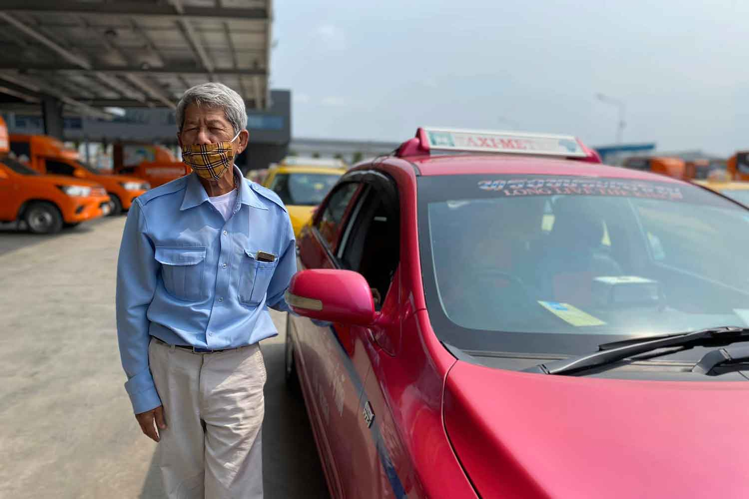 Taxi driver Sitthichai Klaichit poses for photos posted on a TV reporter's