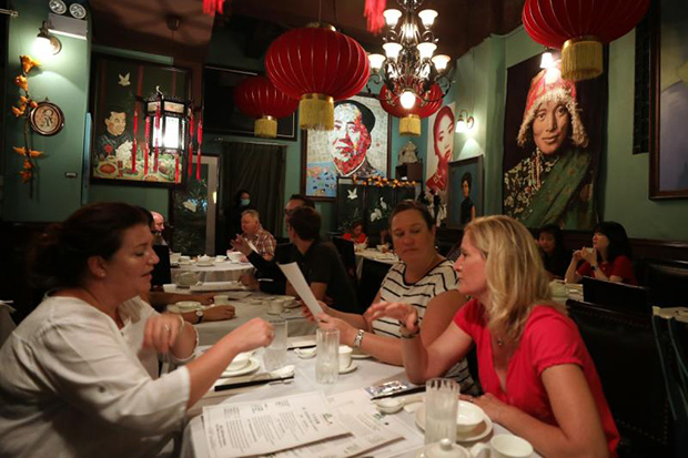 Customers at a restaurant in Central on Friday after the Hong Kong government eased social distancing measures to contain the coronavirus outbreak. (South China Morning Post photo)