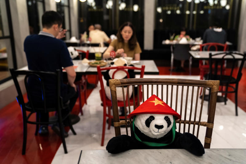 People have dinner as they sit next to stuffed panda dolls, used as part of social distancing measures to prevent the spread of the coronavirus disease, at the Maison Saigon restaurant that reopened after the easing of restrictions in Bangkok, on Wednesday. (Reuters photo)