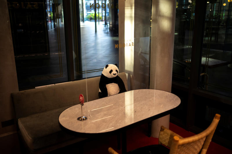 A stuffed panda doll and a plastic barrier are used as part of social distancing measures to prevent the spread of the coronavirus disease, at the Maison Saigon restaurant that reopened after the easing of restrictions in Bangkok, on Wednesday. (Reuters photo)