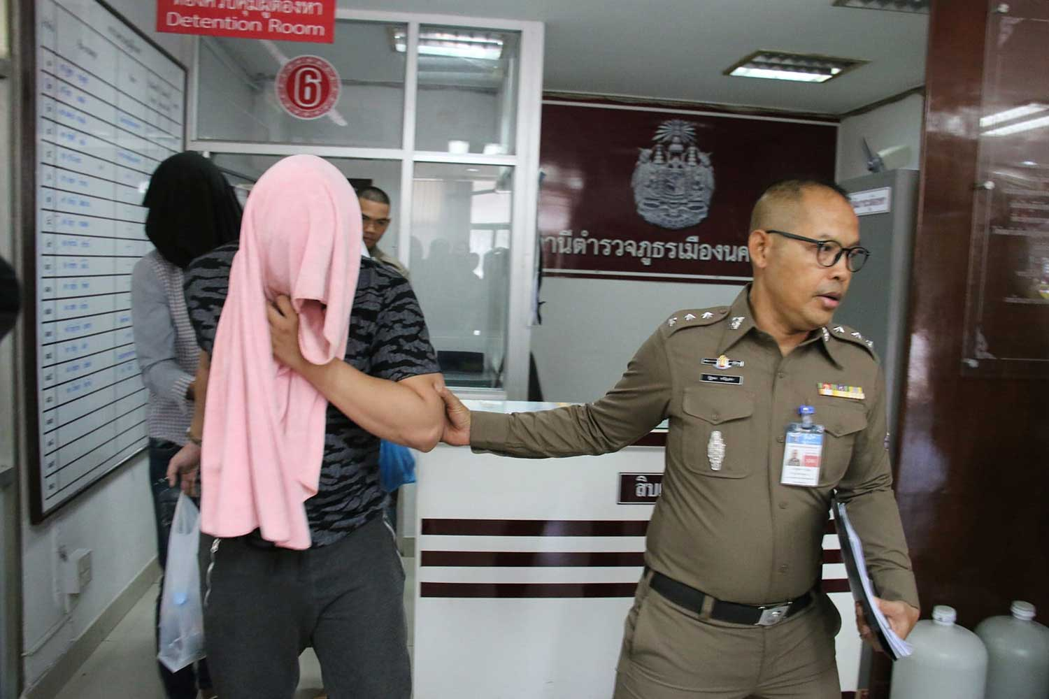 Natthaphol Thavornphibun, owner of Ban Phi Nat tutorial school in Nakhon Sawan, his wife and his mother-in-law, are taken to Nakhon Sawan prison after being interrogated over the fatal beating of student Thapakorn Sapsin, 15, at Muang district police station in June last year. (File photo: Chalit Poomrueng)