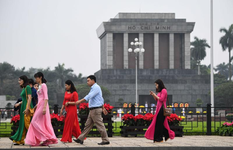 People walk past the Ho Chi Minh mausoleum in Hanoi on March 2, 2019 ahead of a planned visit by North Korea's leader Kim Jong Un. (AFP photo)