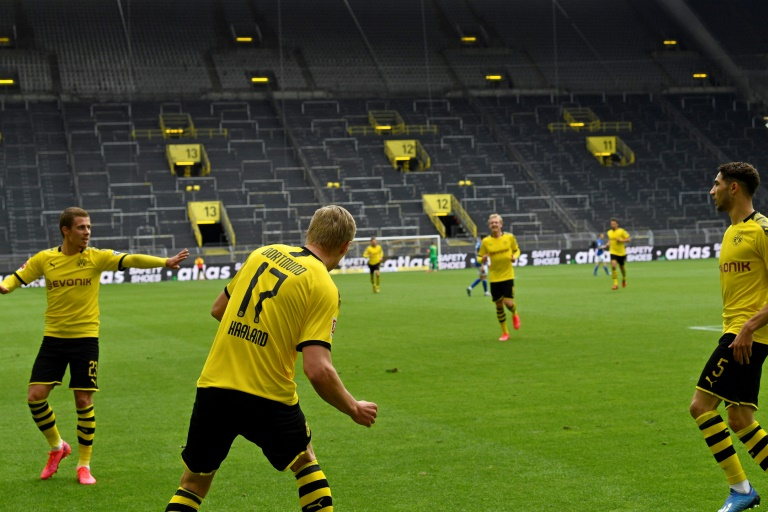 Erling Braut Haaland keeps his distance after opening the scoring in Borussia Dortmund's 4-0 win over local rivals Schalke.