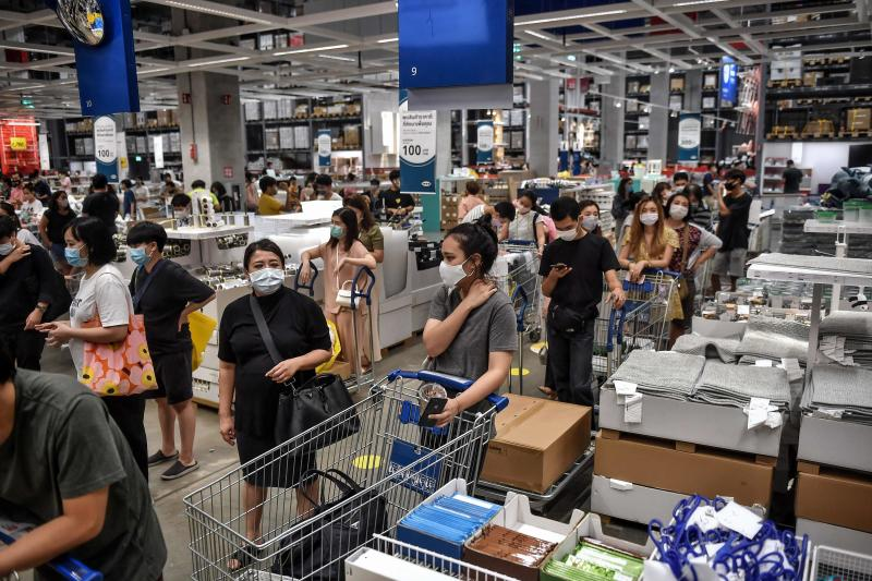 Long queues are seen at the cashiers at IKEA as it reopened after restrictions to halt the spread of the Covid-19 coronavirus were lifted in Bangkok on Sunday. (AFP photo)